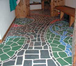 You can create interesting patterns on your floors using a variety of latex paints.