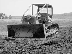 Old dozers like this 1951 D7 are often available at a reasonable price and are suitable for pond construction and other dirt moving on the homestead.