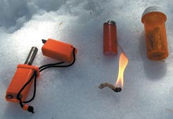 The Strike Force flint-and-steel, a butane lighter, and fire wicks kept together in a container; throw in a little fire-making know-how, and this pocket-size kit virtually guarantees fire in any weather.