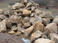A pile of stone in the rockyard, waiting to be sorted