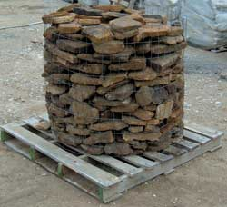 'Palletized' stone awaiting delivery to a customer. Note the wire cylinder that holds the stone.