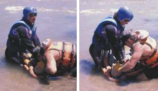 Two members of a local search and rescue unit practice CPR.