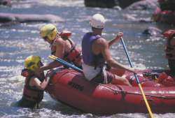 A 'swimmer' can be pulled back into the raft by grabbing the life vest and falling backwards.