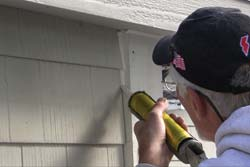 A bead of polyurethane caulk along corners, followed by paint, is the final step.