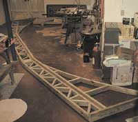 The trusses were built in my basement workshop over the winter.