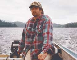 Using typical transportaion for Thorne Bay, Jon Stram rides in his 17-foot boat with 6-horsepower motor.