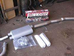 The Flowmaster Cat-Back exhaust system parts are lined up and ready to install.