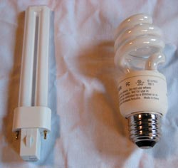 Keyed base PL style compact-fluorescent lamp without ballast on left, and self-ballasted compact-fluorescent lamp on right.
