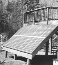 Roof-mounted solar PV array attached to house