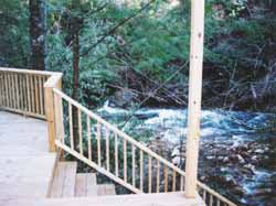 Rear deck steps lead down to the water's edge.