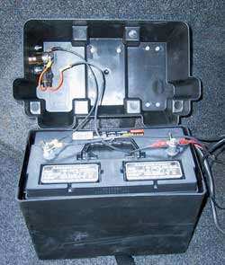 Battery and battery box. Note cigarette auxiliary power socket and in-line fuse mounted in lid.