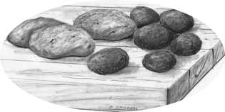 Drawing of potatoes on cutting board.
