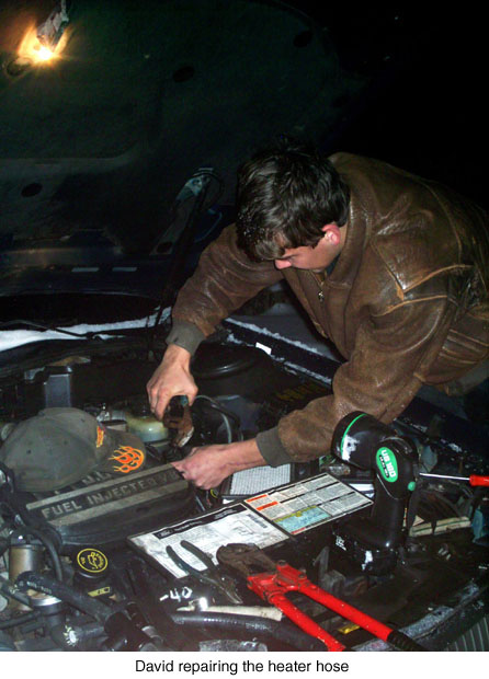 david-repairing-the-heater-hose-jpeg.jpg