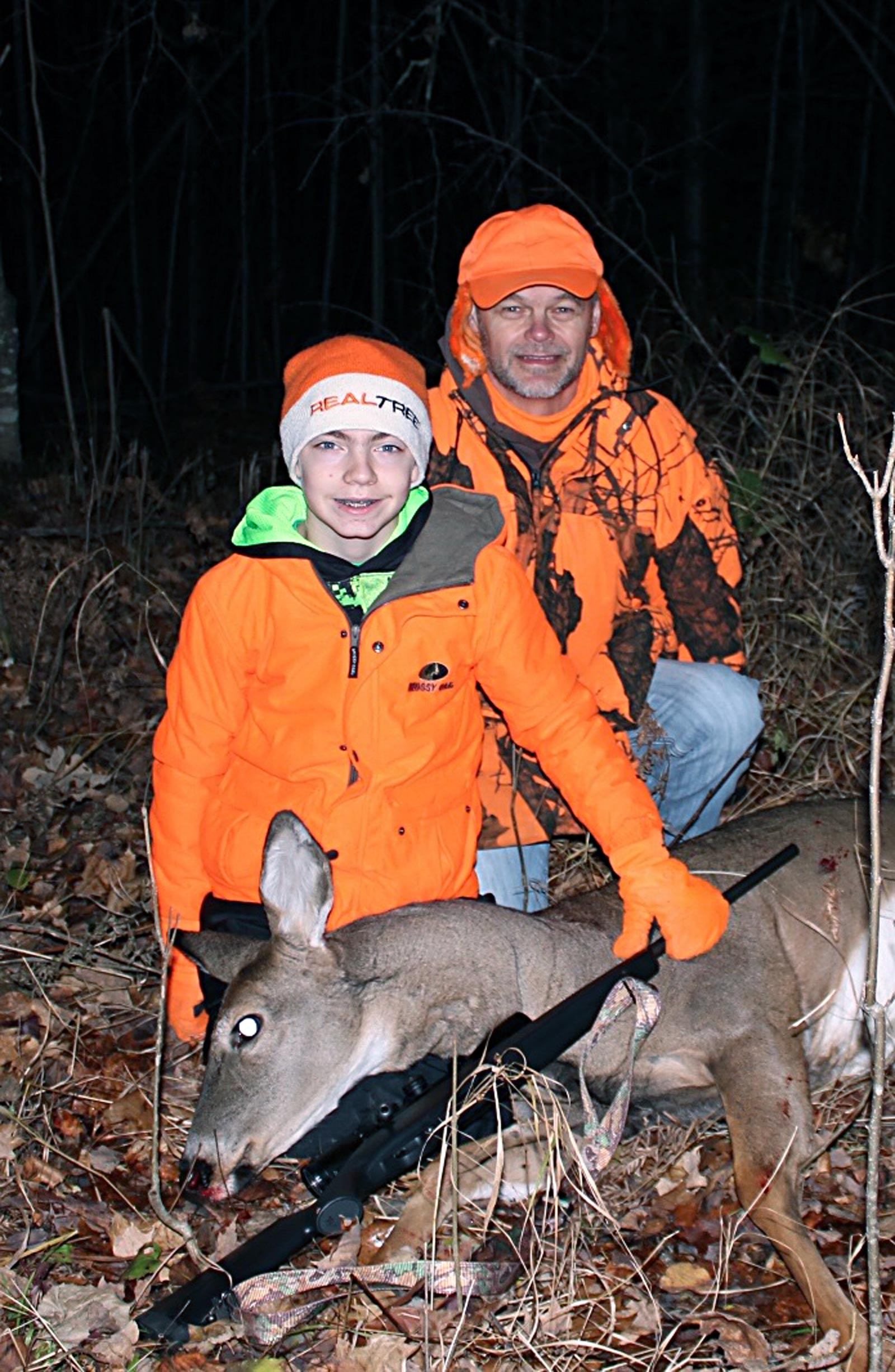 Bill and Mason with his deer. Not bad for 12 years old.