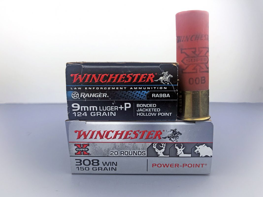 a box of rifle ammo, a box of pistol ammo and a shotgun shell