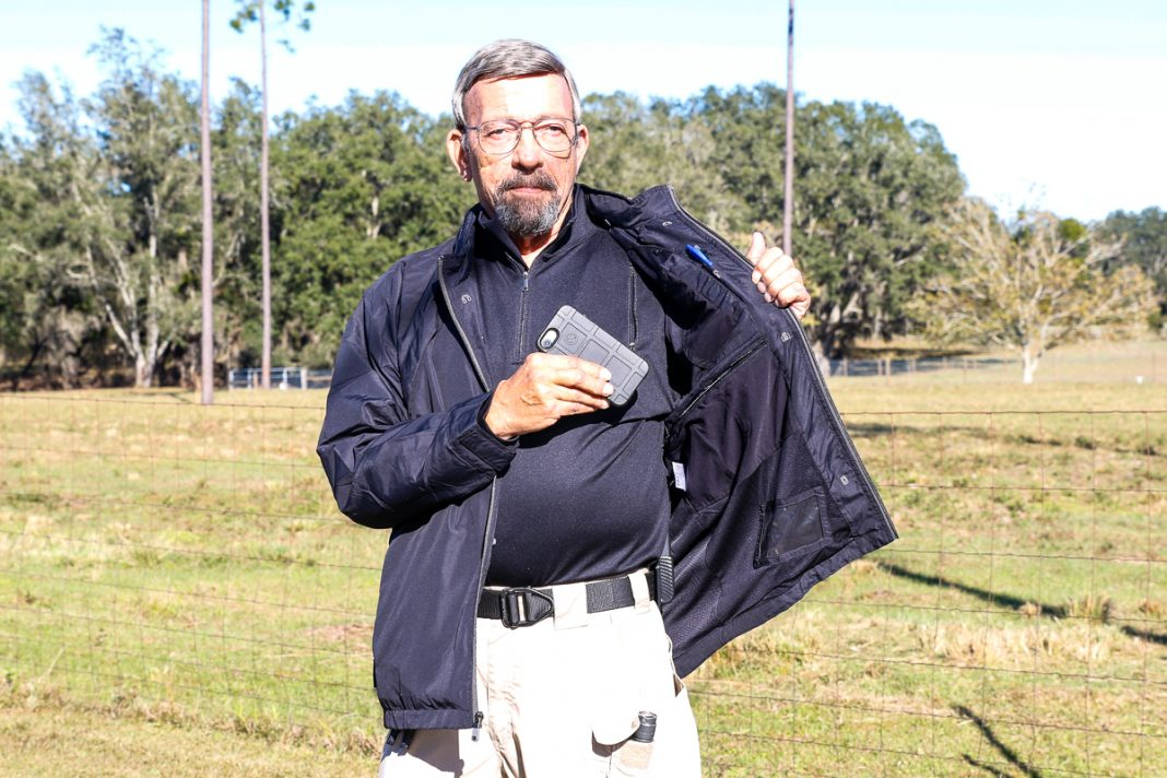 Massad Ayoob wearing a SCOTTeVEST Jacket and pullover