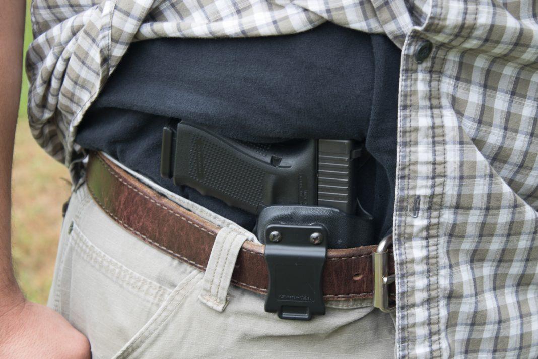 A Glock Handgun in an appendix holster