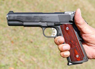 A 1911 pistol in hand